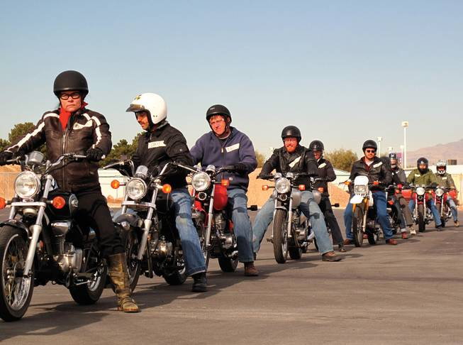 The Dobermen Motorcycle Club revs its engines.