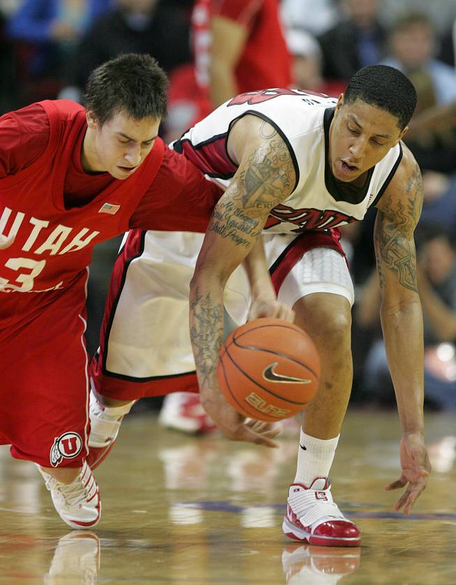 UNLV guard Tre'Von Willis and Utah guard Marshall Henderson chase down a loose ball during the second half of a Jan. 16 Mountain West Conference game. Utah won the game, 73-69.