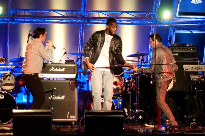 Reallionaire Jream, center, joins Modern Science on stage Saturday during a performance at the Hard Rock Cafe on the Strip.