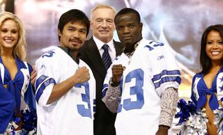 Manny Pacquiao and Joshua Clottey join Dallas Cowboys owner Jerry Jones on-stage during a press conference at Dallas Cowboys Stadium in Arlington, Texas on Jan. 19, 2010. The two welterweights are scheduled to meet on March 13 at Dallas Cowboys Stadium.