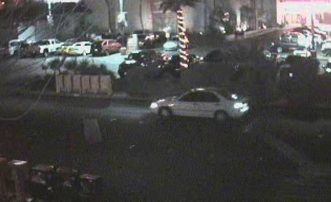 Metro Police say someone exited this white car at Hooters on the Strip and approached the vehicle of a woman who was later found dead in her abandoned car.