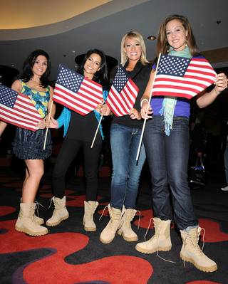 The contestants of the 2010 Miss America Pageant trade their high heels for combat boots.