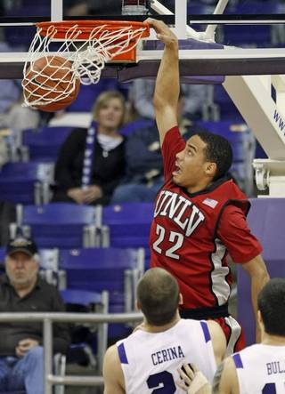 UNLV's Chace Stanback, top, dunks over TCU players Nikola Cerina and Zvonko Buljan in the first half of UNLV's 79-70 victory on Jan. 23, 2010, at Daniel-Meyer Coliseum in Fort Worth, Texas.
