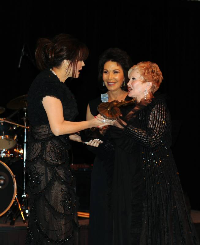 Marie Osmond accepts her NBT Woman of the Year honor from NBT co-chairs Nancy Houssels, far right, and Wendy Plaster.