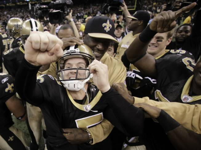 New Orleans Saints kicker Garrett Hartley (5) celebrates with his teammates after kicking the winning field goal during overtime in the NFC Championship NFL football game in New Orleans, Sunday, Jan. 24, 2010. The Saints defeated the Vikings 31-28 to advance to the Super Bowl against the Indianapolis Colts.