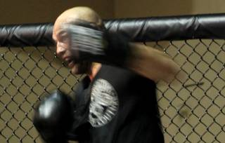 UFC light heavyweight Randy Couture works out in preparation for his main event fight in UFC 109 against Mark Coleman.