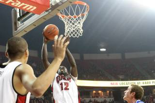 Brice Massamba lays it in for two of his six first half point as UNLV takes on Air Force at the Thomas & Mack Tuesday.