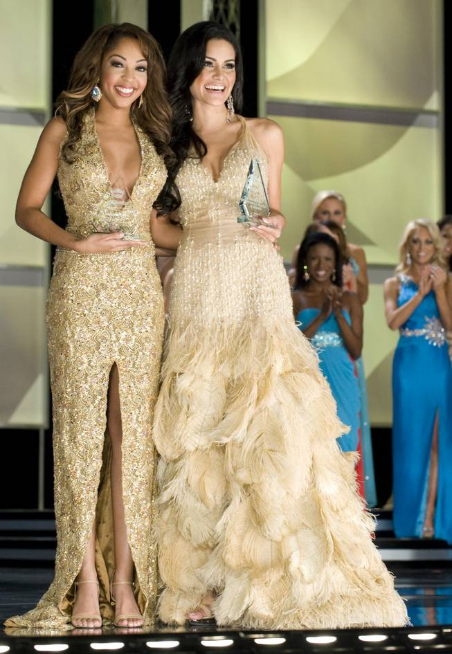 Miss Virginia Caressa Cameron and Miss Puerto Rico Mimi Pabon at the 2010 Miss America Pageant preliminary competition at Planet Hollywood on Jan. 26, 2010.