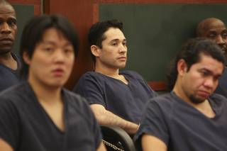 Porfirio Duarte-Herrera, center, sits in court waiting to be called for sentencing before District Court Judge Michael P. Villani Thursday at the Regional Justice Center.  Duarte-Herrera was sentenced to life without parole for the Luxor bombing that killed Willebaldo Dorantes Antonio in May 2007.