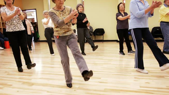 Seniors participate in a dance class during the Heritage Park grand opening in Henderson Saturday, January 30, 2010.