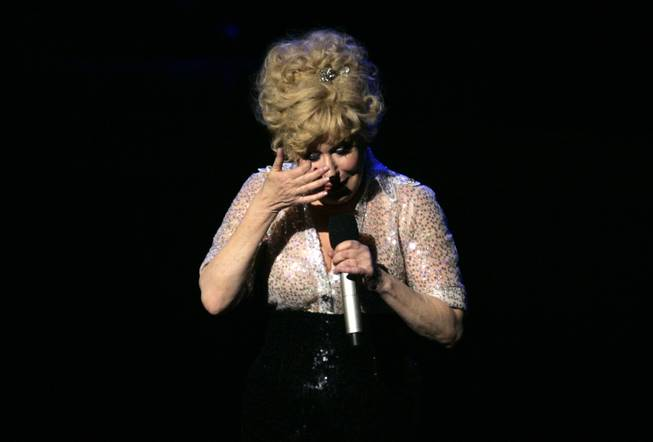 "Bette Midler wipes away a tear during the final show of ""The Showgirl Must Go On"" at Caesars Palace Sunday, January 31, 2010."