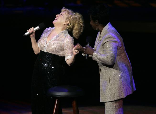 "Bette Midler laughs with surprise guest Gadys Knight during the final show of ""The Showgirl Must Go On"" at Caesars Palace Sunday, January 31, 2010."