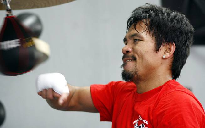 Manny Pacquiao works the bag during a workout at Wildcard Boxing Gym in Hollywood, Calif. on Feb. 1, 2010.
