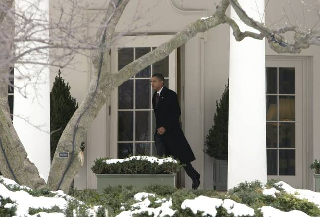 President Barack Obama leaves the White House in Washington, Tuesday, Feb. 2, 2010, for a trip to New Hampshire to push one of his State of the Union proposals: funneling $30 billion to local banks so they can lend small businesses money they need to grow their enterprises and create jobs.