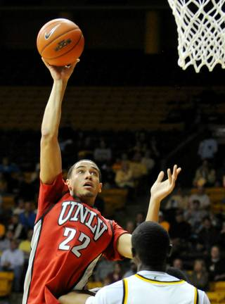 UNLV forward Chace Stanback puts up a shot against Wyoming during Wednesday's game in Laramie, Wyo.