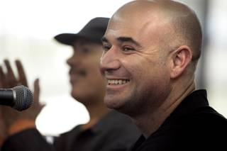 Musician Carlos Santana visits with Andre Agassi at The Andre Agassi College Preparatory Academy in Las Vegas Thursday, February 4, 2010.