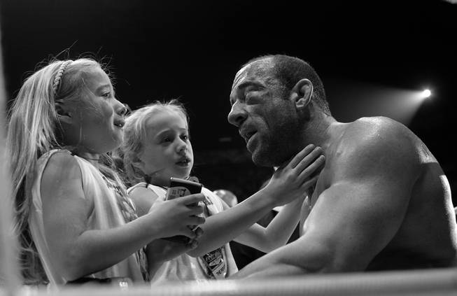 "To calm the tears and fears of his daughters, Mark Coleman repeats over and over that ""Daddy's OK. Daddy's OK,"" after being defeated by Fedor Emelianenko in the second round of their heavyweight bout at Pride Fighting Championships first U.S. event, ""The Real Deal,"" at the Thomas & Mack Center. When his repeated reassurance that ""Daddy's OK, it's all over. It's all over. Daddy's OK. Let's go have some fun now,"" failed to completely calm the girls, Coleman took them to center ring and introduced them to the man who turned his face into a bloody pulp. Then, after a minute or two of talk, Coleman playfully tagged the Russian champion with light tap to the chin and then raised his arms in victory."