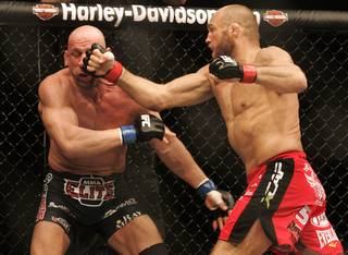 Randy Couture tags Mark Coleman with a right during their light heavyweight bout at UFC 109 Saturday, Feb. 6, 2010, at the Mandalay Bay Events Center. Couture won the battle of UFC Hall of Fame fighters by submission in the second round.