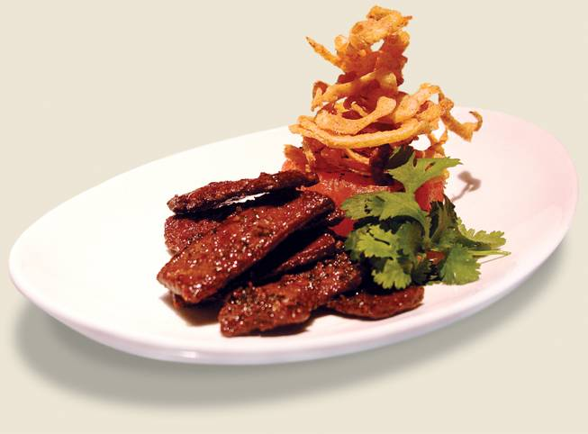 Strip House's beef jerky: a lowbrow snack turned scrumptious.