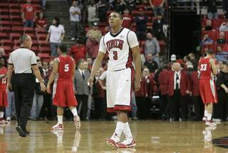 UNLV guard Anthony Marshall looks at the scoreboard as the final seconds tick away during the second half of their Mountain West Conference game against New Mexico Wednesday, Feb. 10, 2010, at the Thomas & Mack Center. The Lobos held off a late Rebel charge to win 76-66.
