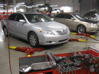 Mechanics at Findlay Toyota in Henderson repair recalled vehicles for sticky gas pedals and unsecured floor mats Wednesday, Feb. 10, 2010.