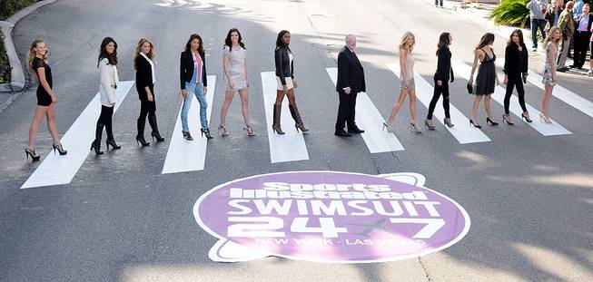 Mayor Oscar Goodman welcomes the 2010 <em>Sports Illustrated</em> swimsuit edition models at The Mirage on Feb. 10, 2010.