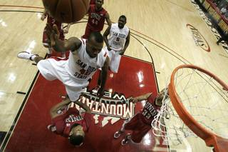 UNLV guard Anthony Marshall draws a charge from San Diego State guard Kelvin Davis during the first half of their Mountain West Conference game Saturday, Feb. 13, 2010 at Viejas Arena in San Diego. San Diego State won the game 68-58.