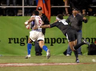 Samoan's Reupena Levasa outruns New Zealand's Lote Raikabula in the final of the USA Sevens International Rugby Tournament on Feb. 14, 2010. Samoa defeated New Zealand 33-12 for the tournament championship.