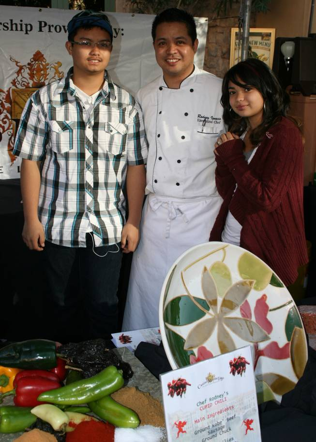 People's choice winner Chef Rodney Ignacio of Casino MonteLago poses with his family at the Lake Las Vegas Chili Cook-off.