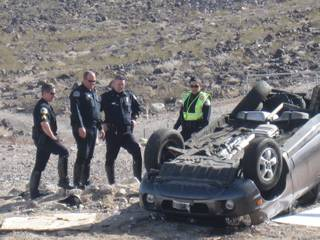 Henderson Police investigate a fatal two-vehicle crash on West Horizon Ridge Parkway Tuesday.