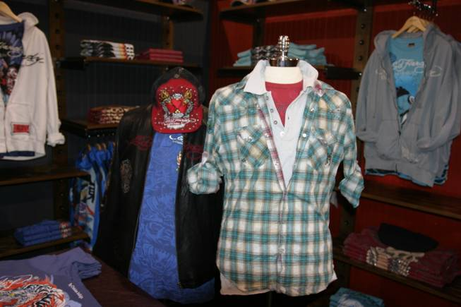Christian Audigier clothing and products on display at the MAGIC convention.