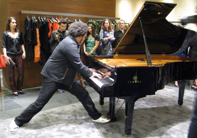 """Rockjazz"" prodigy Eric Lewis plays the piano at the new Fendi store inside Crystals at CityCenter."