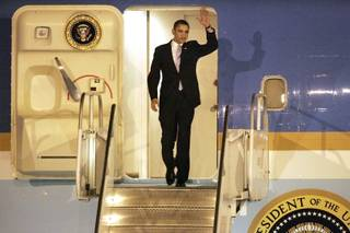 President Barack Obama exits Air Force One after arriving at McCarran International Airport in Las Vegas on Thursday.