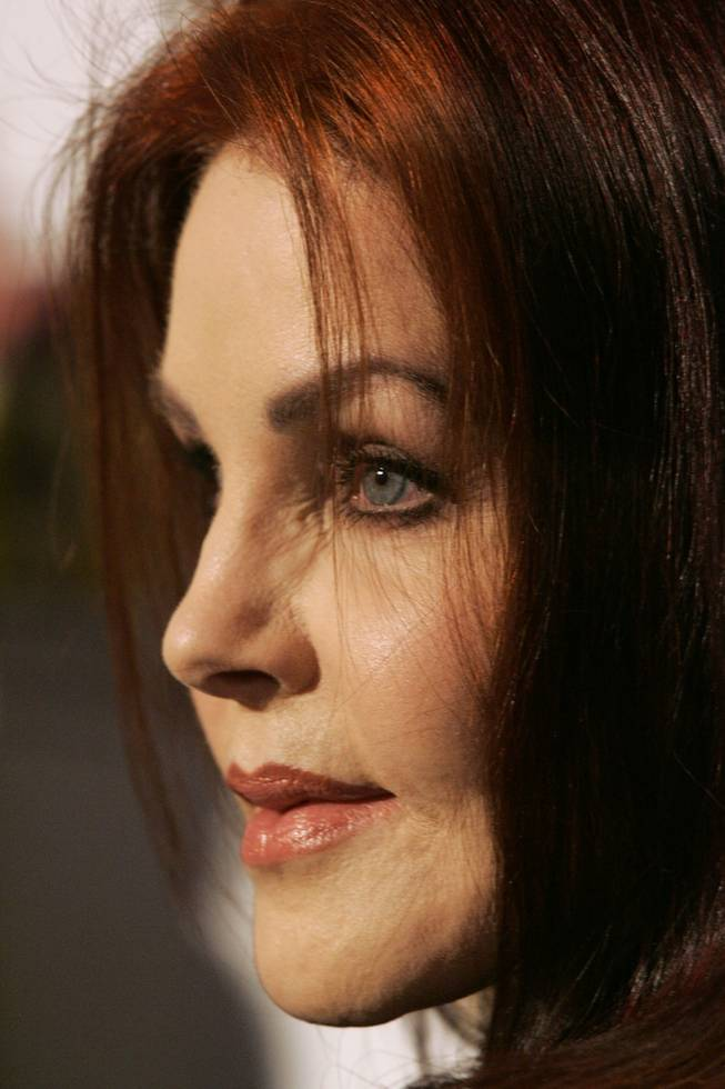 "Priscilla Presley poses for the cameras during the blue carpet premiere of Cirque du Soleil's ""Viva Elvis"" at the Aria Resort & Casino at CityCenter."