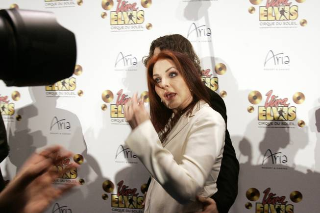 "Priscilla Presley walks by the media Friday during the blue carpet premiere of Cirque du Soleil's ""Viva Elvis"" at the Aria Resort & Casino at CityCenter."