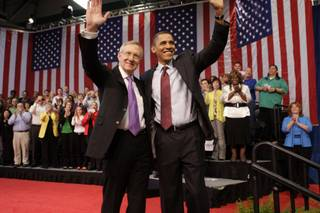 Senate Majority Leader Harry Reid (D-Nev.) and President Barack Obama wave as they conclude a town hall meeting at Green Valley High School in Henderson Friday, February 19, 2010.