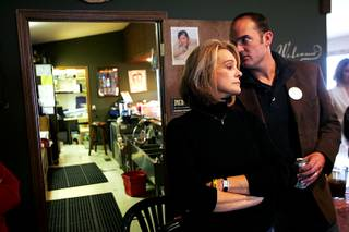 Campaign manager Robert Uithoven whispers to Senate candidate Sue Lowden during a Lincoln Day lunch in Battle Mountain Saturday, February 20, 2010.