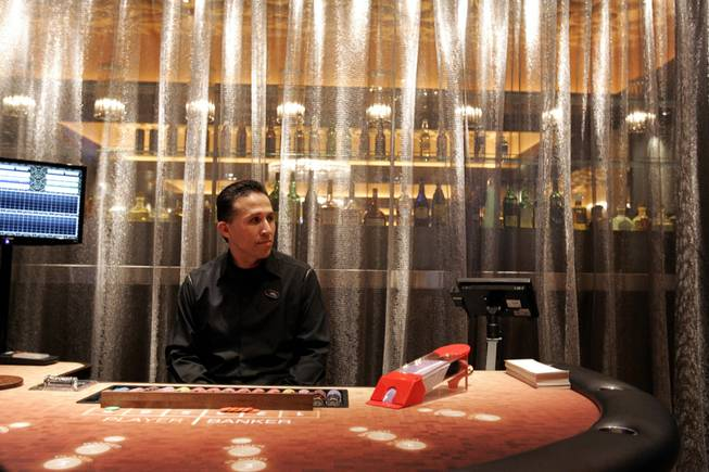Dealer Joe Carrion waits inside the high-limit baccarat room in January at the Hard Rock Hotel.