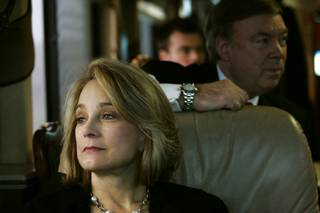 Senate candidate Sue Lowden looks out the window while she and her husband Paul Lowden travel on her campaign bus to a Lincoln Day dinner in Minden Sunday, February 21, 2010.