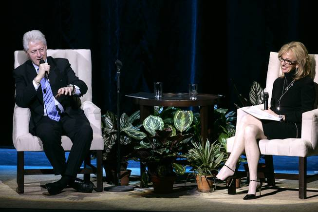 Former President Bill Clinton sits down to answer questions with Jan Jones, senior vice president of communications and government relations for Harrah's Entertainment, in front of a crowd of Harrah's employees at the Colosseum at Caesars Palace in Las Vegas Monday, Feb. 22, 2010.