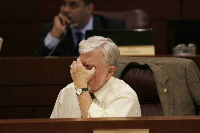 Assemblyman Joe Hogan rubs his eyes during a Monday meeting of the Interim Finance Committee. One difficult choice for Nevada lawmakers is whether to shift money from the Millennium Scholarship and the Dairy Commission to the state's general fund.