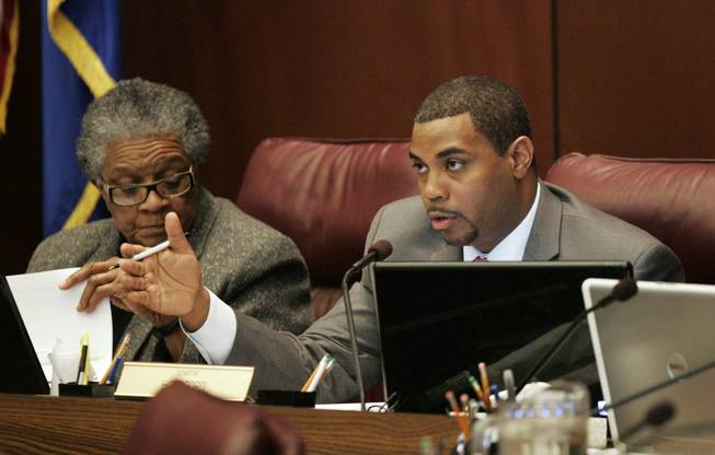 Senate Majority Leader Steven Horsford asks State Budget Director Andrew Clinger a question on the first day of the legislative special session Tuesday, Feb. 23, 2010 in Carson City.