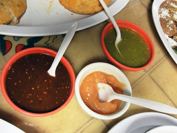 A trio of red chile, green chile and habanero salsas at Antojos DF.