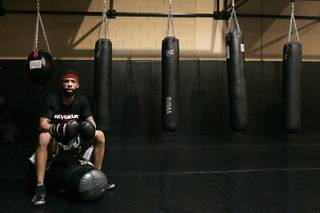 Mixed Martial Arts fighter LC Davis rests between workouts at Xtreme Couture Gym in Las Vegas Wednesday, February 24, 2010.