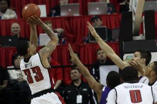UNLV guard Tre'Von Willis shoots a jumper over the outstretched arms of the TCU defense Wednesday at the Thomas & Mack Center.  The Rebels won the second straight, 78-62.