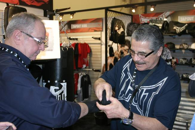 "Jacob ""Stitch"" Duran demonstrates his wrapping skills at the TapouT booth at the MAGIC tradeshow."