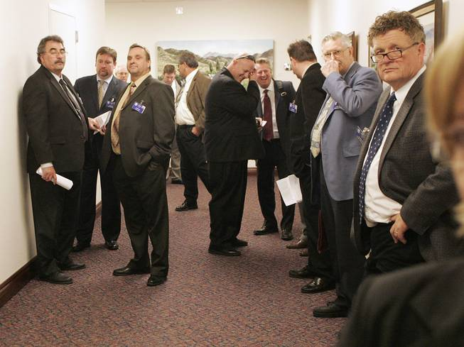 Lobbyists congregate in a hallway on Day 3 of the special legislative session Thursday, Feb. 25, 2010, in Carson City.