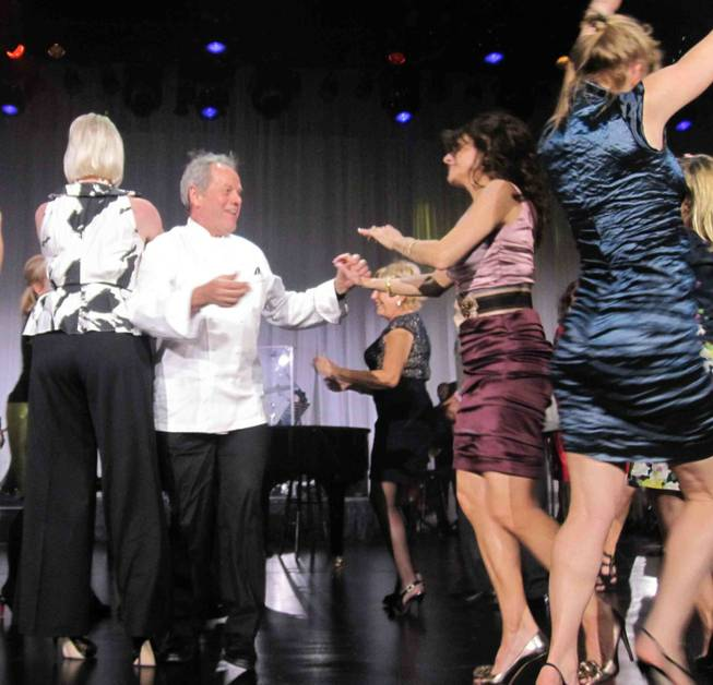 Wolfgang Puck, second from left, joins dancing Barry Manilow fans at the Keep Memory Alive 14th Annual Power of Love Gala at the Bellagio on Feb. 27, 2010.