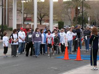 Participants prepare to begin the one-mile walk portion of the Henderson Libraries Read and Run Saturday on Water Street.