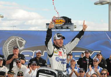 Jimmie Johnson celebrates his victory in the NASCAR Shelby American GT 350 at Las Vegas Motor Speedway on Feb. 28, 2010.